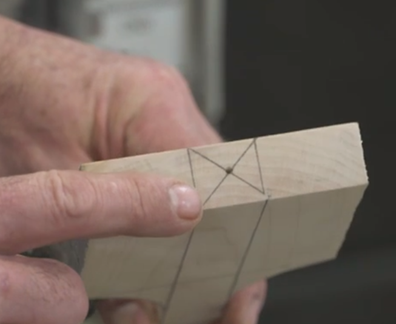 Marking the center of the spatula head preparing for lathe work