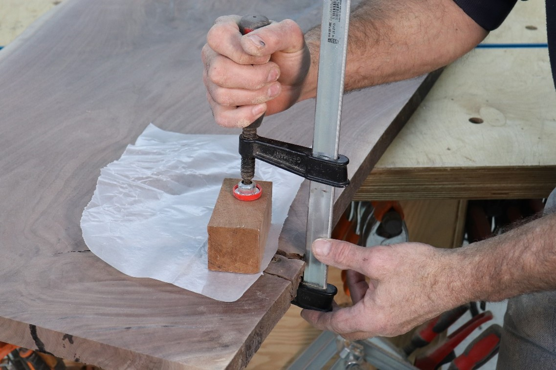 Clamping the combined pieces until inlay sets