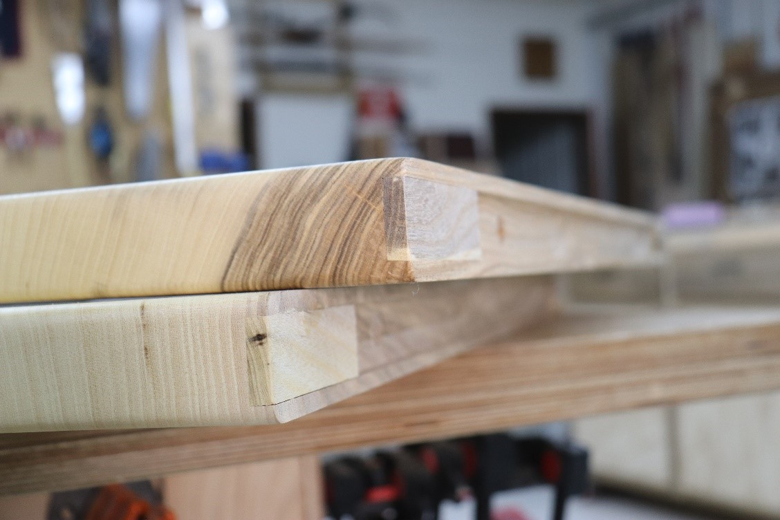 Create a series of plugs to match grain of wood