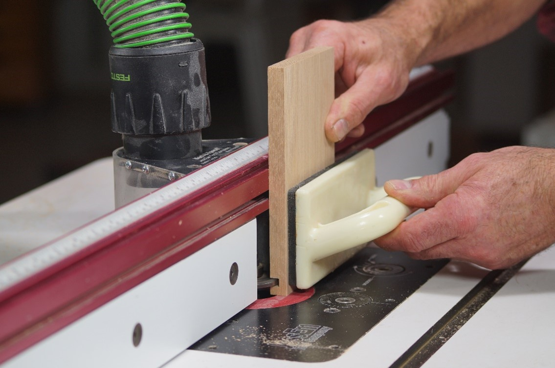 Cutting across the wooden board vertically