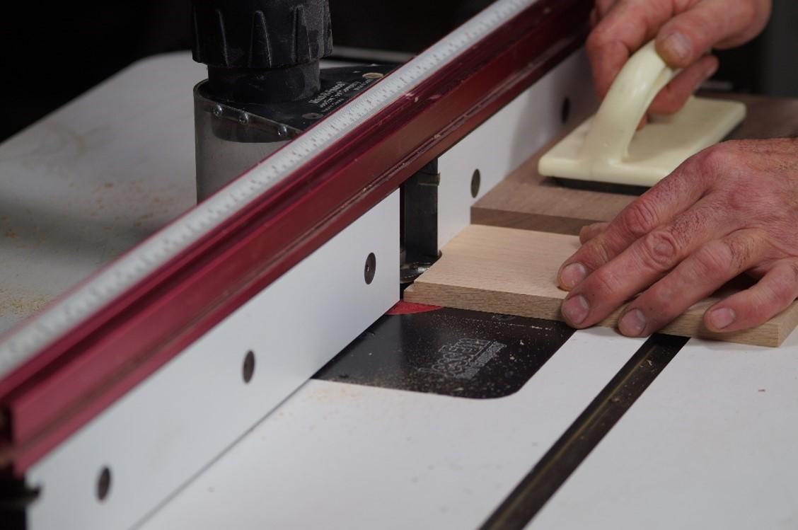 Doing a test cut across the wood board