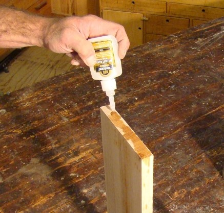 applying ca glue to the end of the plank