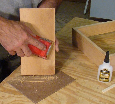 sanding an extra piece of wood