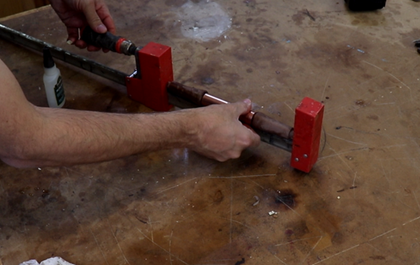 Gluing handle parts together and clamping