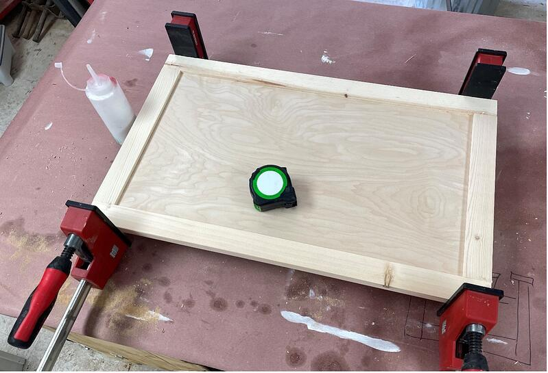 sanding the door panel and aseembling with glue