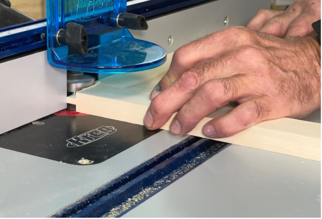 making a test cut on the router table