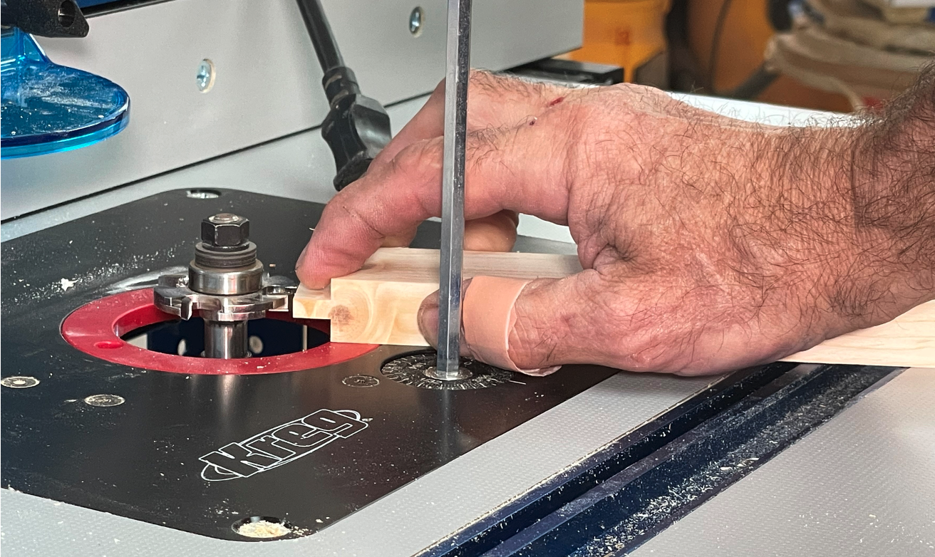 Install the groove cutter in your router table using a door rail