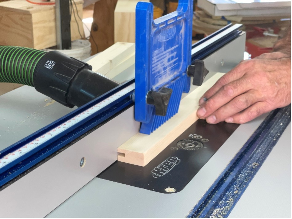 installing a feather board and running the wood