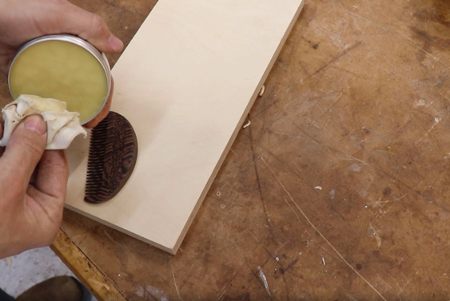 applying an oil finish to the wood for a final result