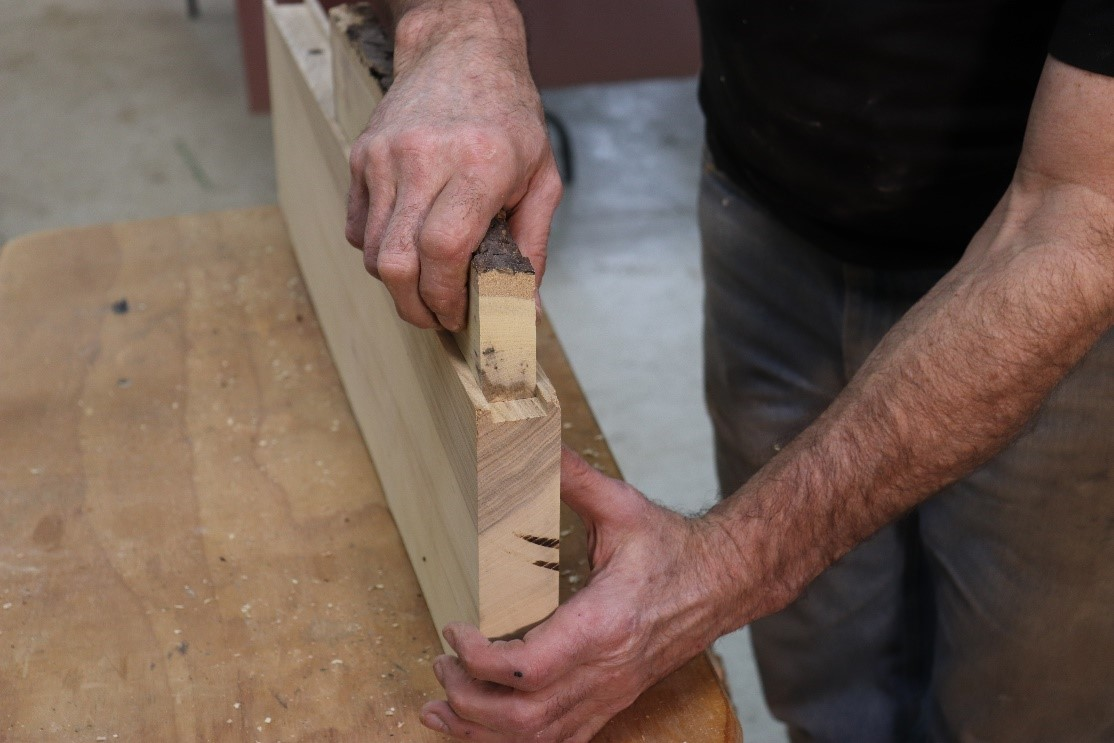 Planing scrapwood until it aligns with groove