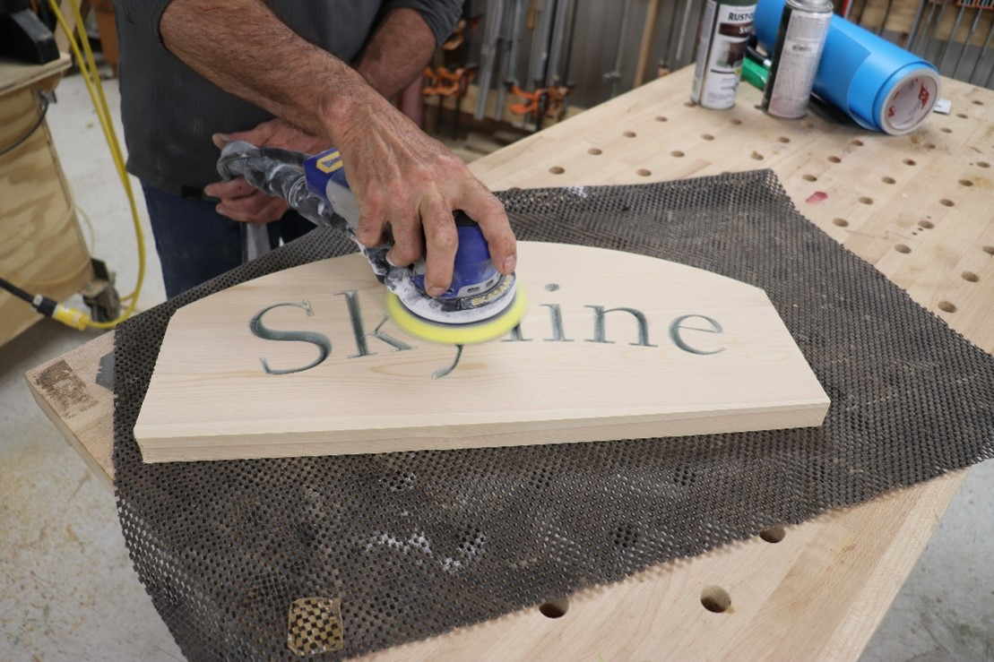 Sanding the face of the sign