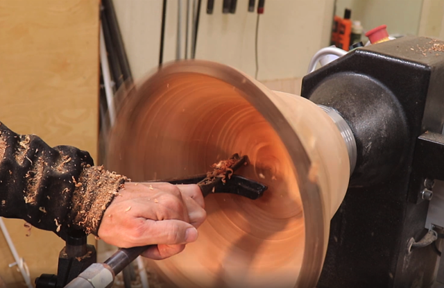 smoothing the bottom of the bowl