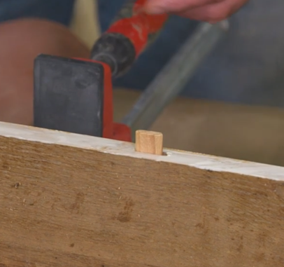 adding adhesive glue to the edge of the wood