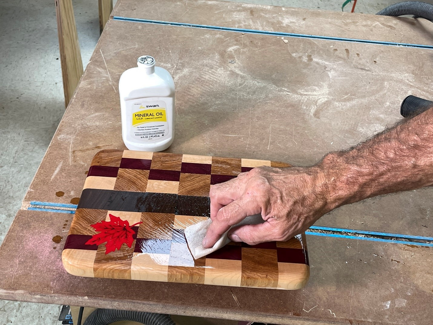 applying mineral oil over the epoxy inlay