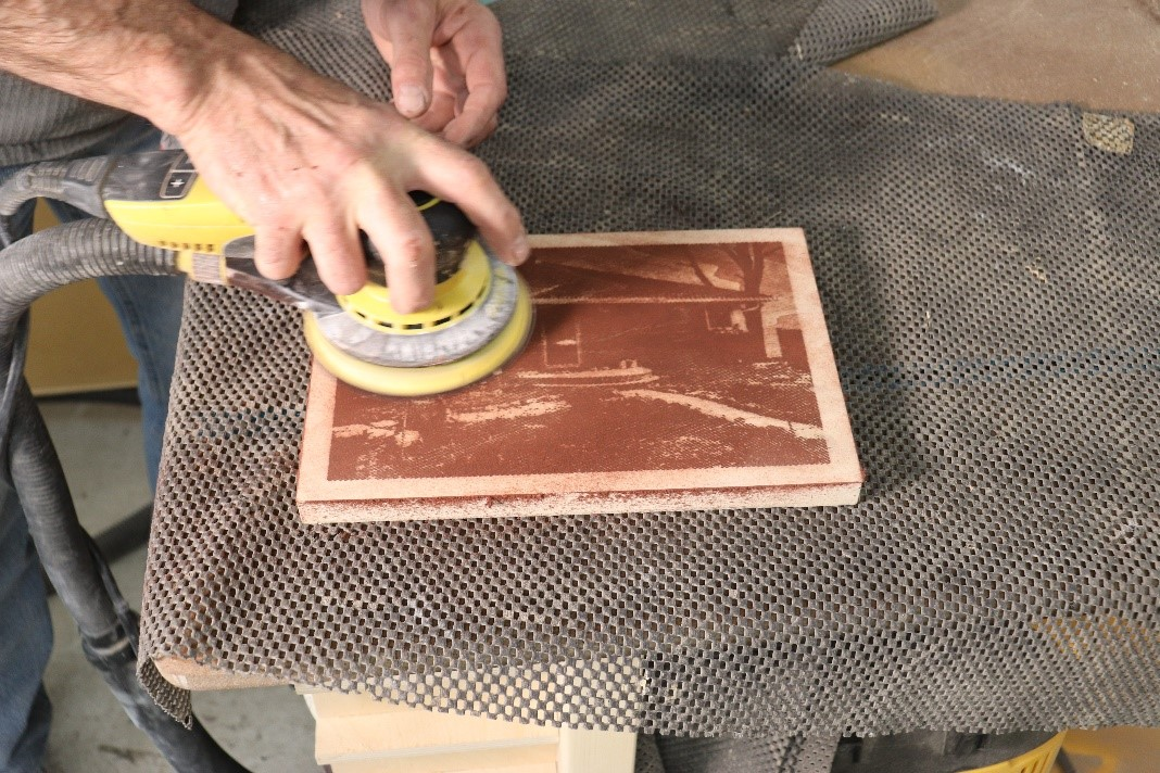 continue sanding until image completely appears