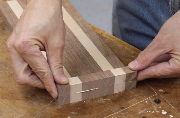 gluing a piece of the panel as an end rail
