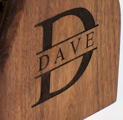laser engraving the custom design on the walnut wood project