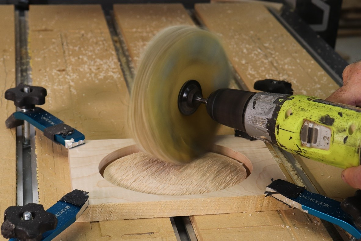 sanding the surface of the wood