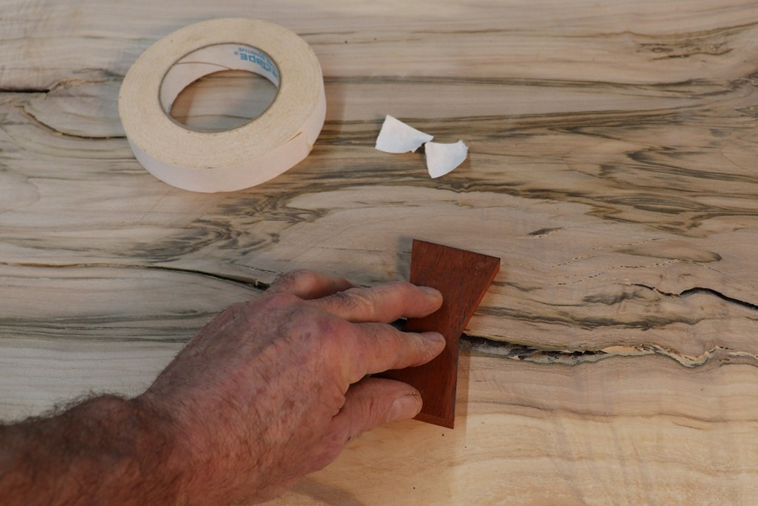 tracing the bowtie on a separate piece of wood