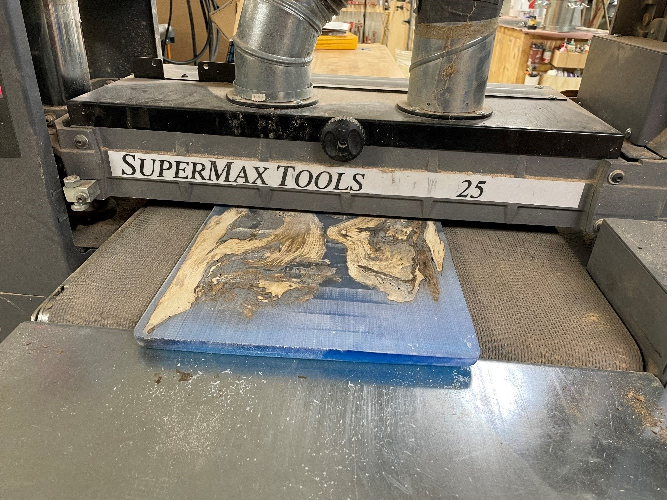 use a drum sander to evenly sand the surface