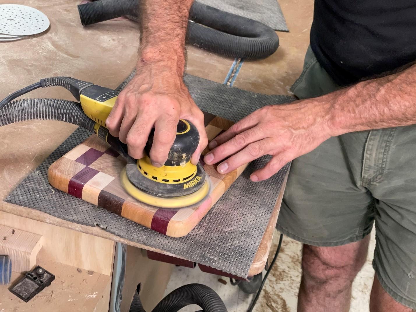 using a hand tool orbit sander