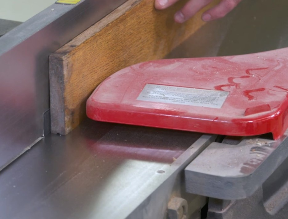 using a jx jointer on the wooden plank